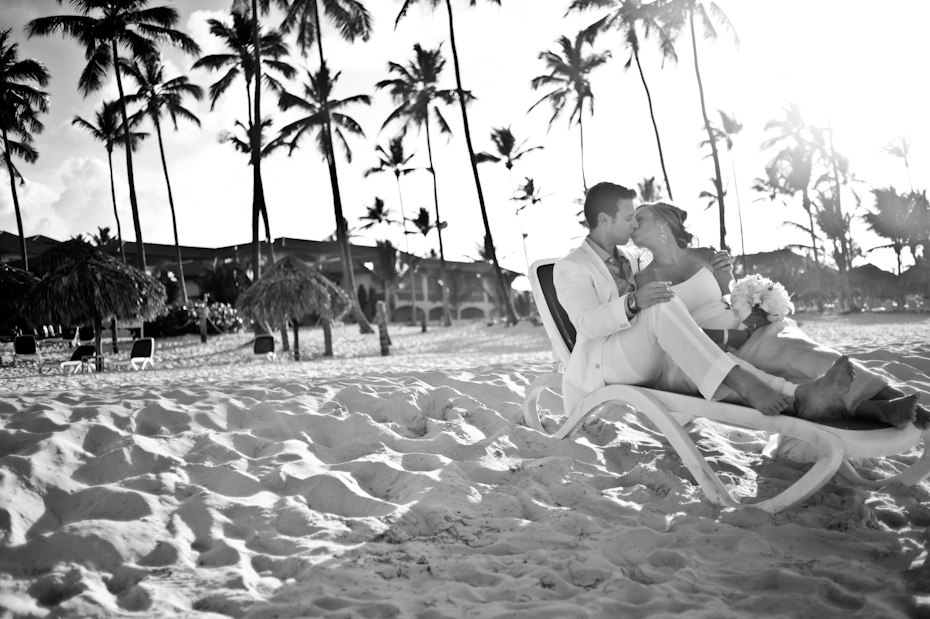 bride and groom on lounge chair
