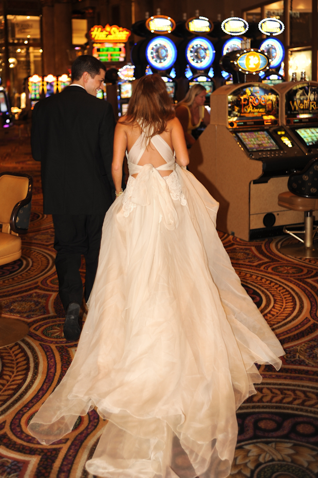 bride and groom in casino in vegas