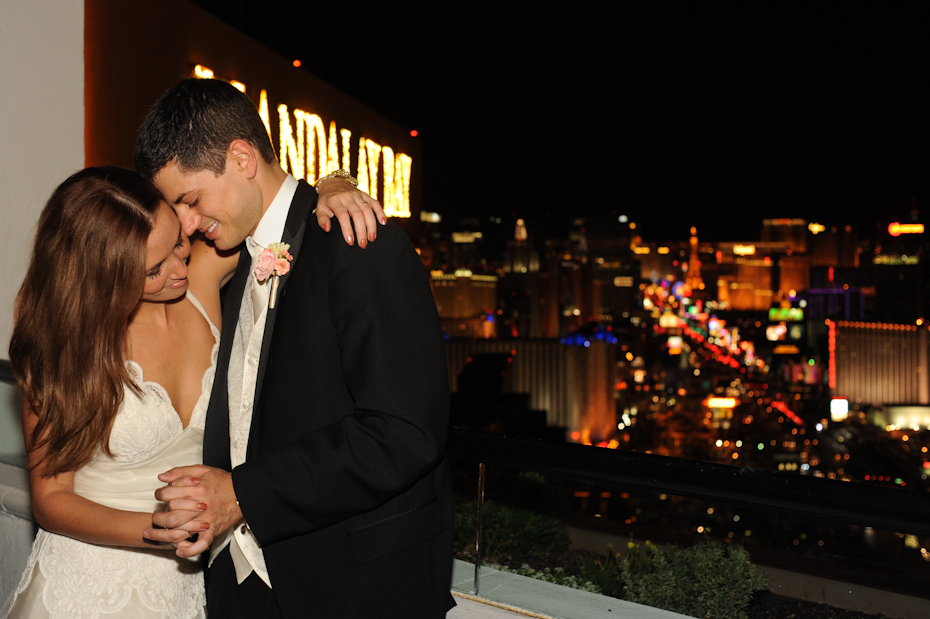 bride and groom with las vegas strip
