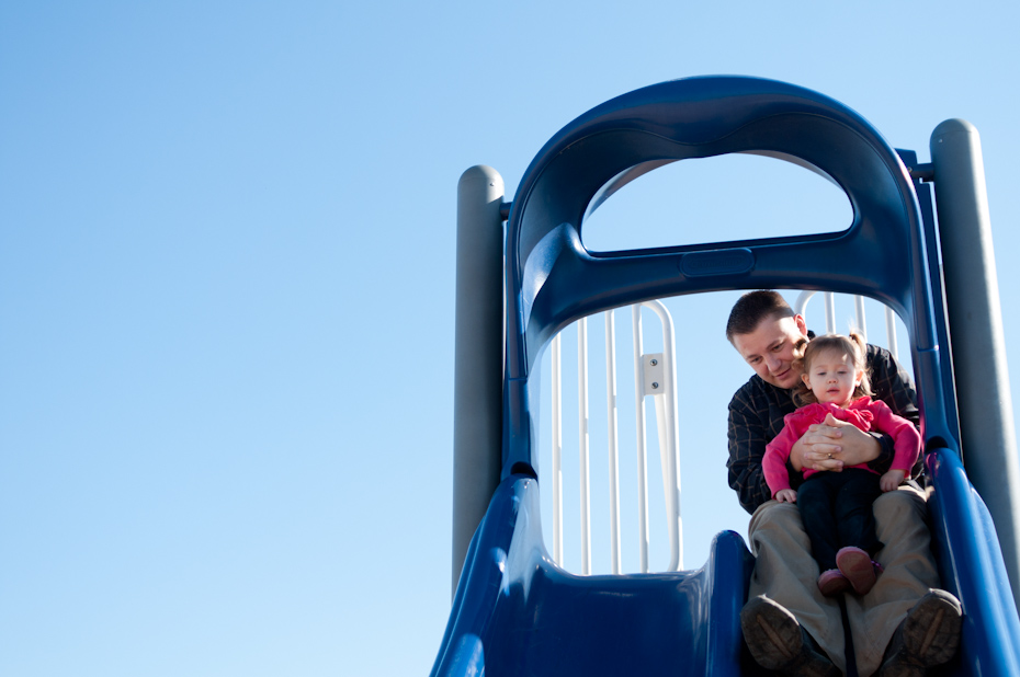 dad with baby on slide