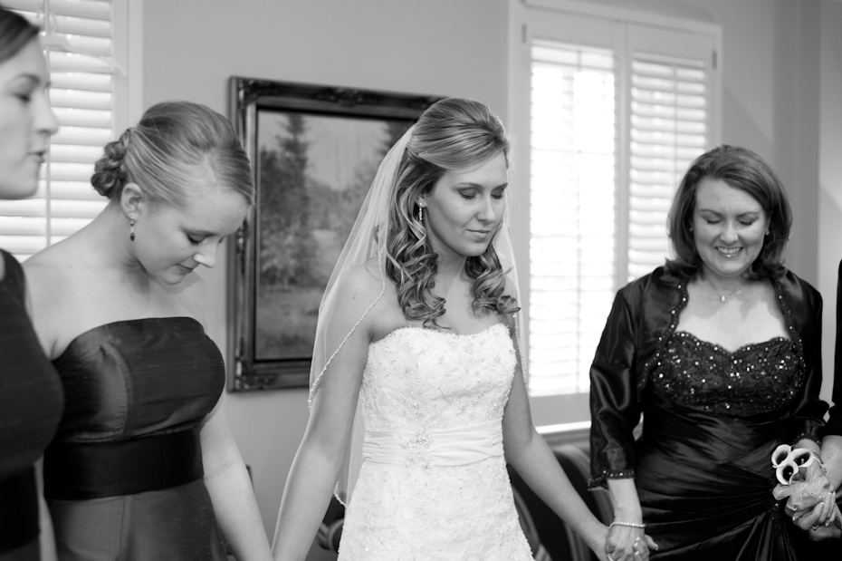 bride praying before ceremony