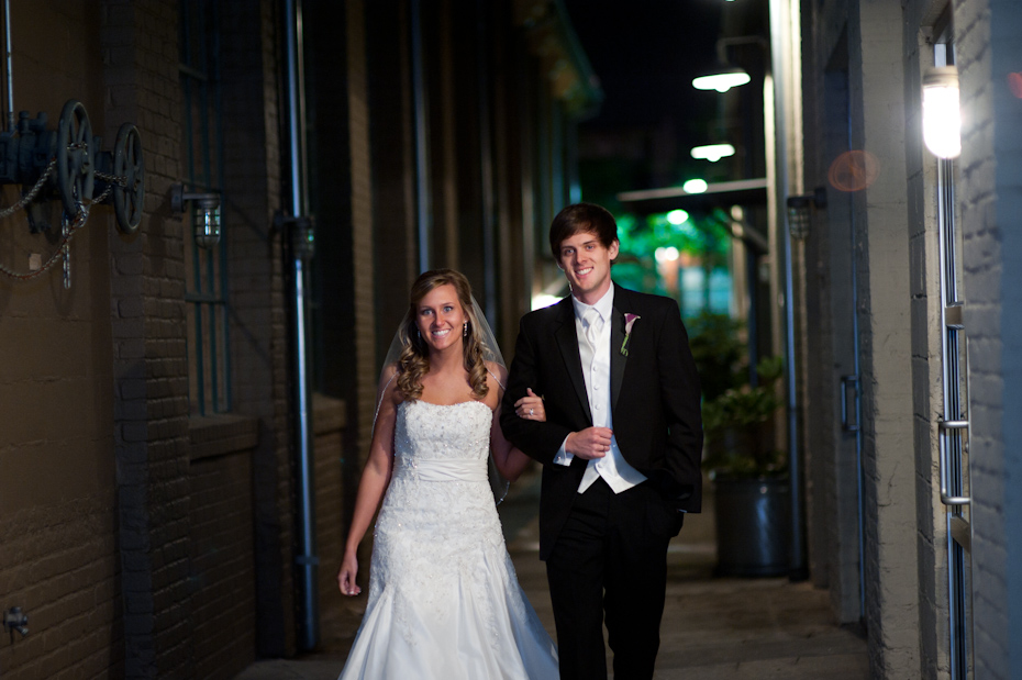 bride and groom arrive at the foundry at puritan mill