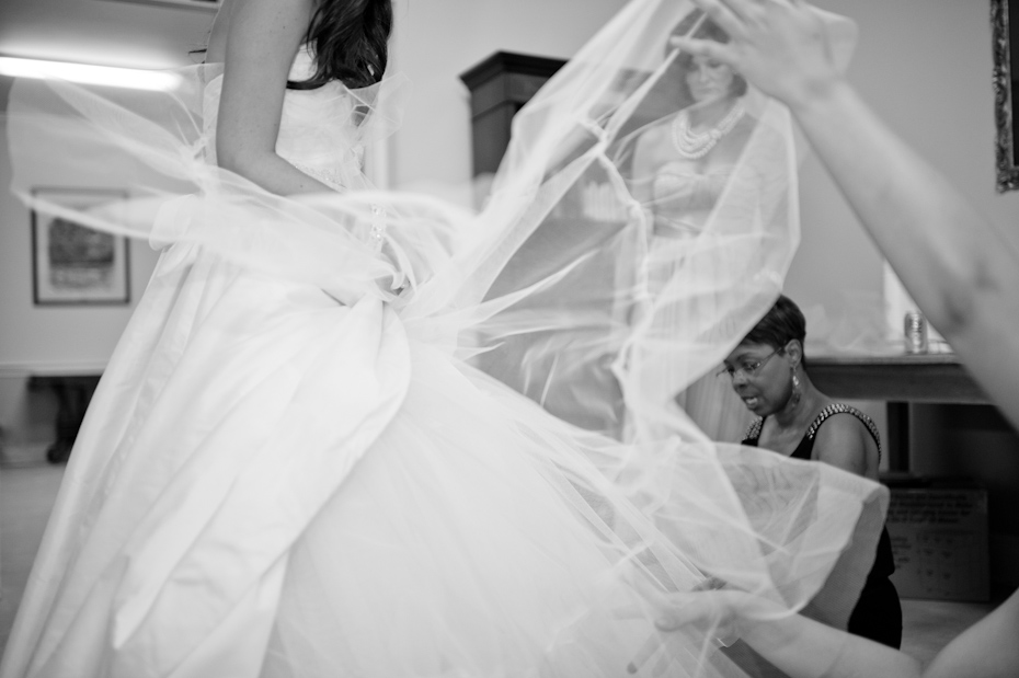 Cutting tulle from under wedding dress