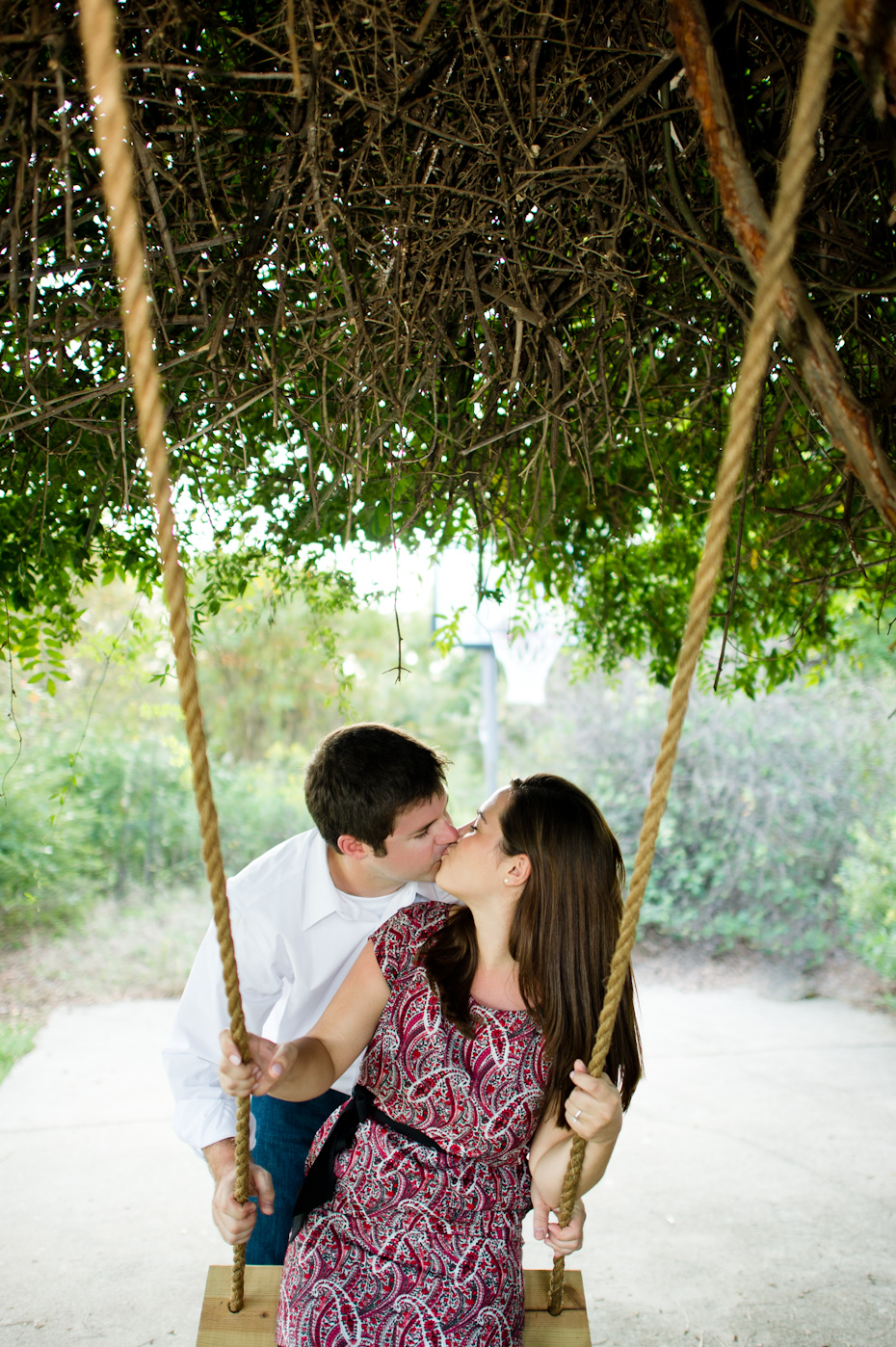 Engagement pictures on a swing