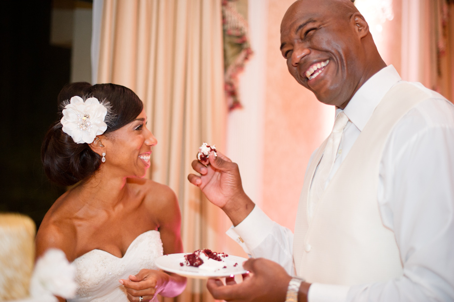 Groom feeding bride