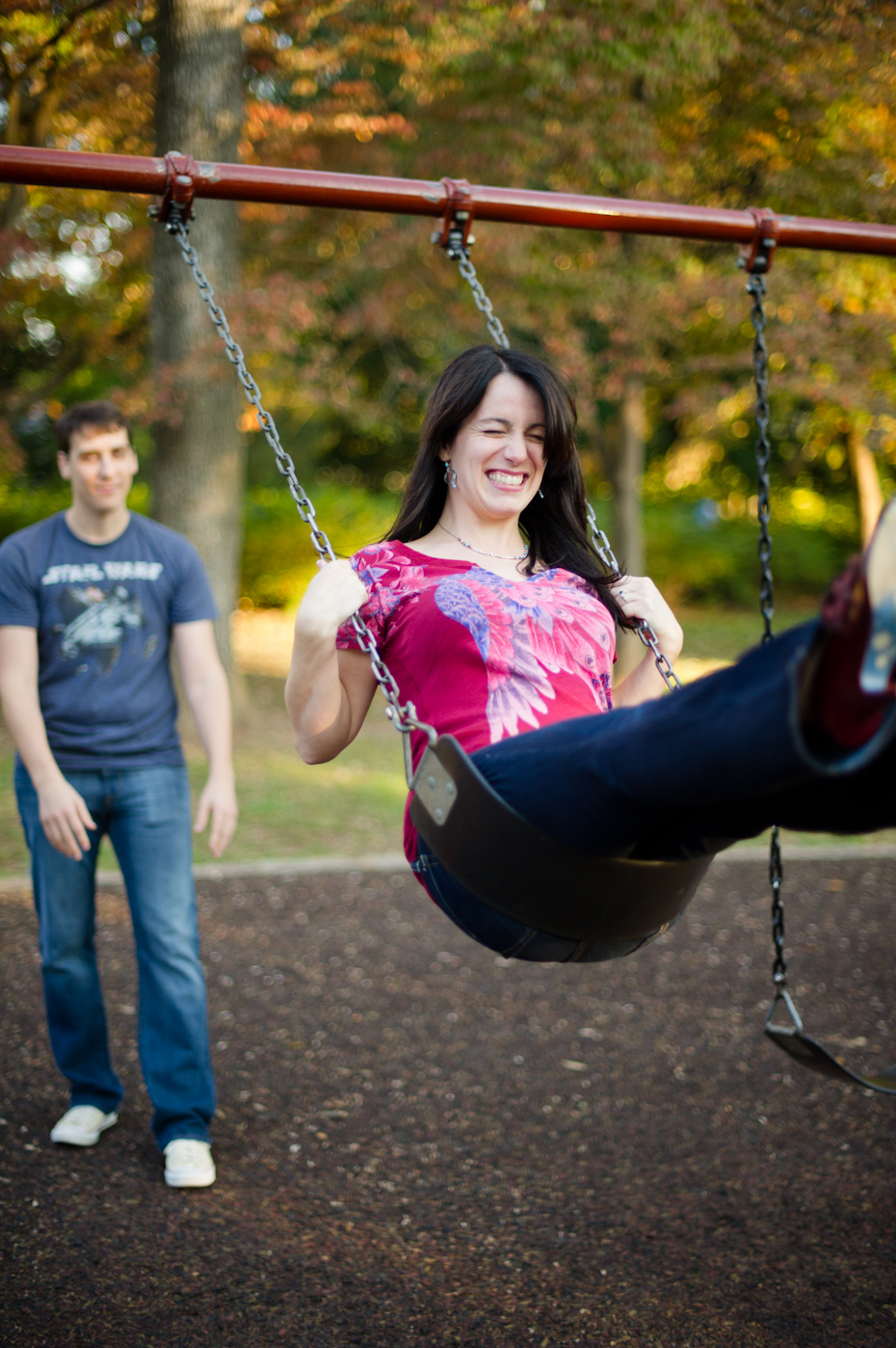 Engagement photo on swing
