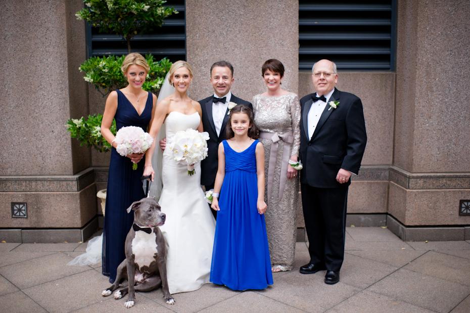 Dog in family photos at wedding