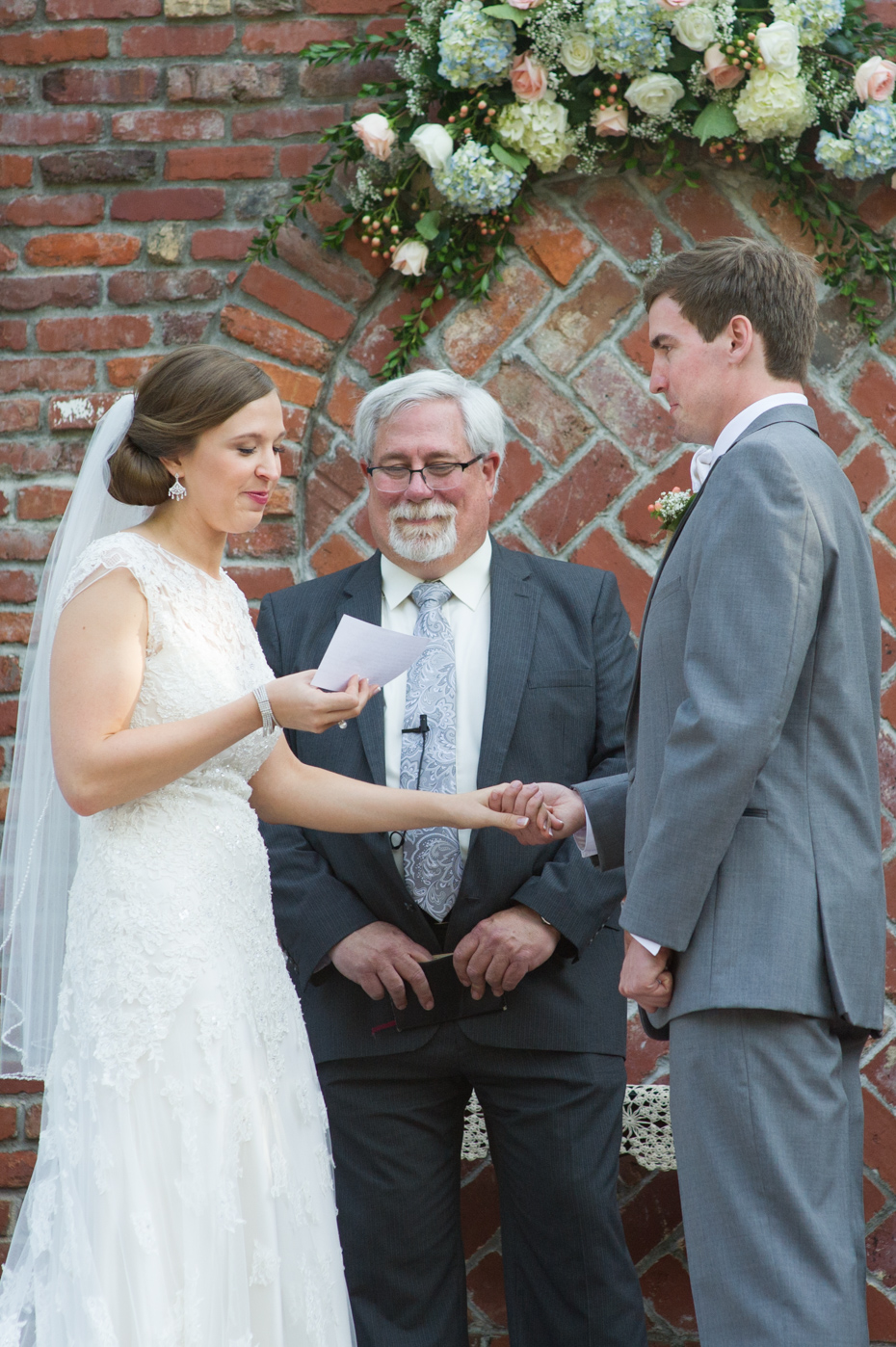 bride reading vows to groom