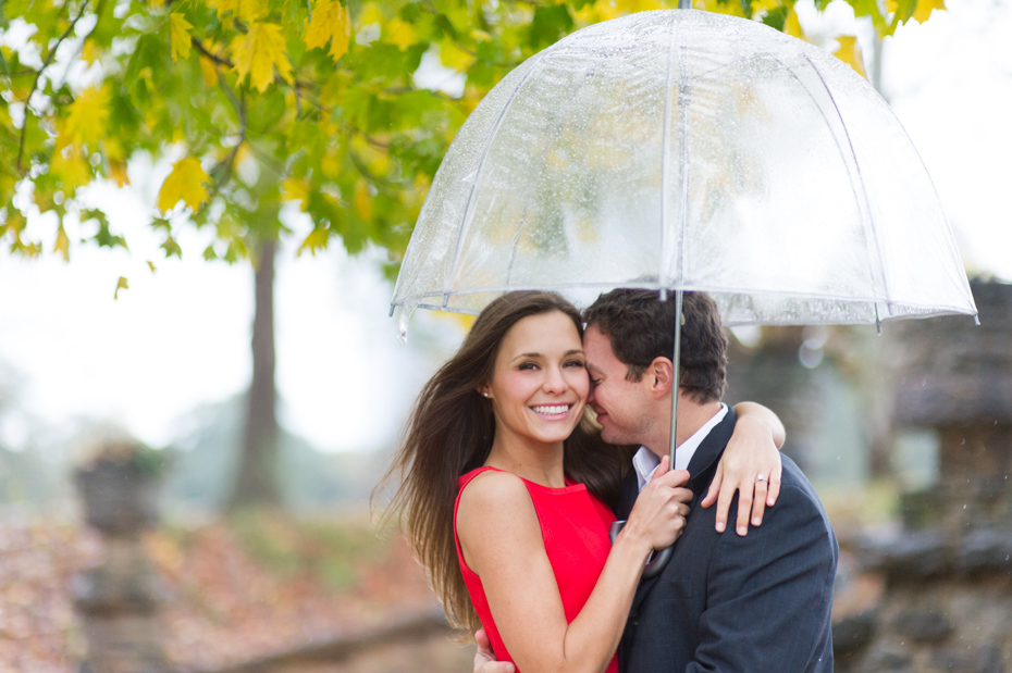 Engagement photos with umbrella on rainy day