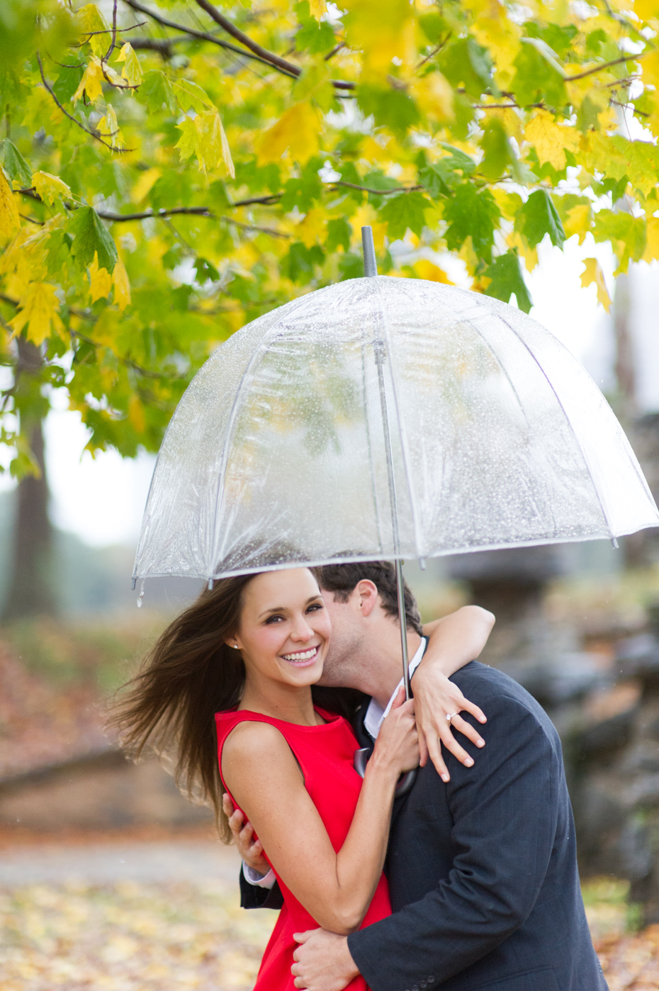 Fun engagement pictures in the rain