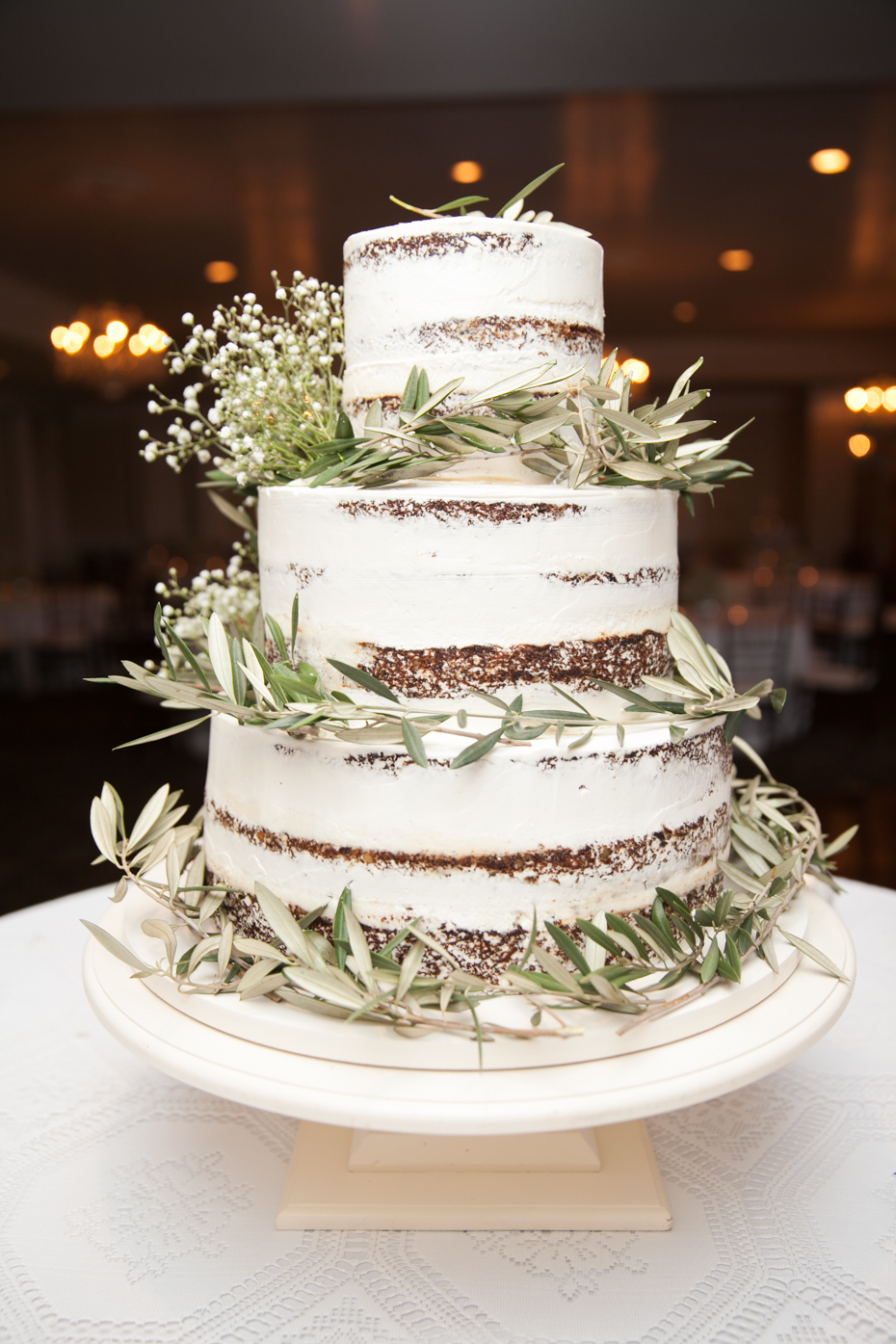 Naked wedding cake with greenery