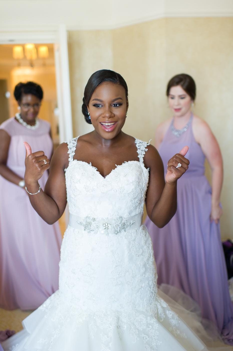 Bride getting dressed in St. Regis bridal suite
