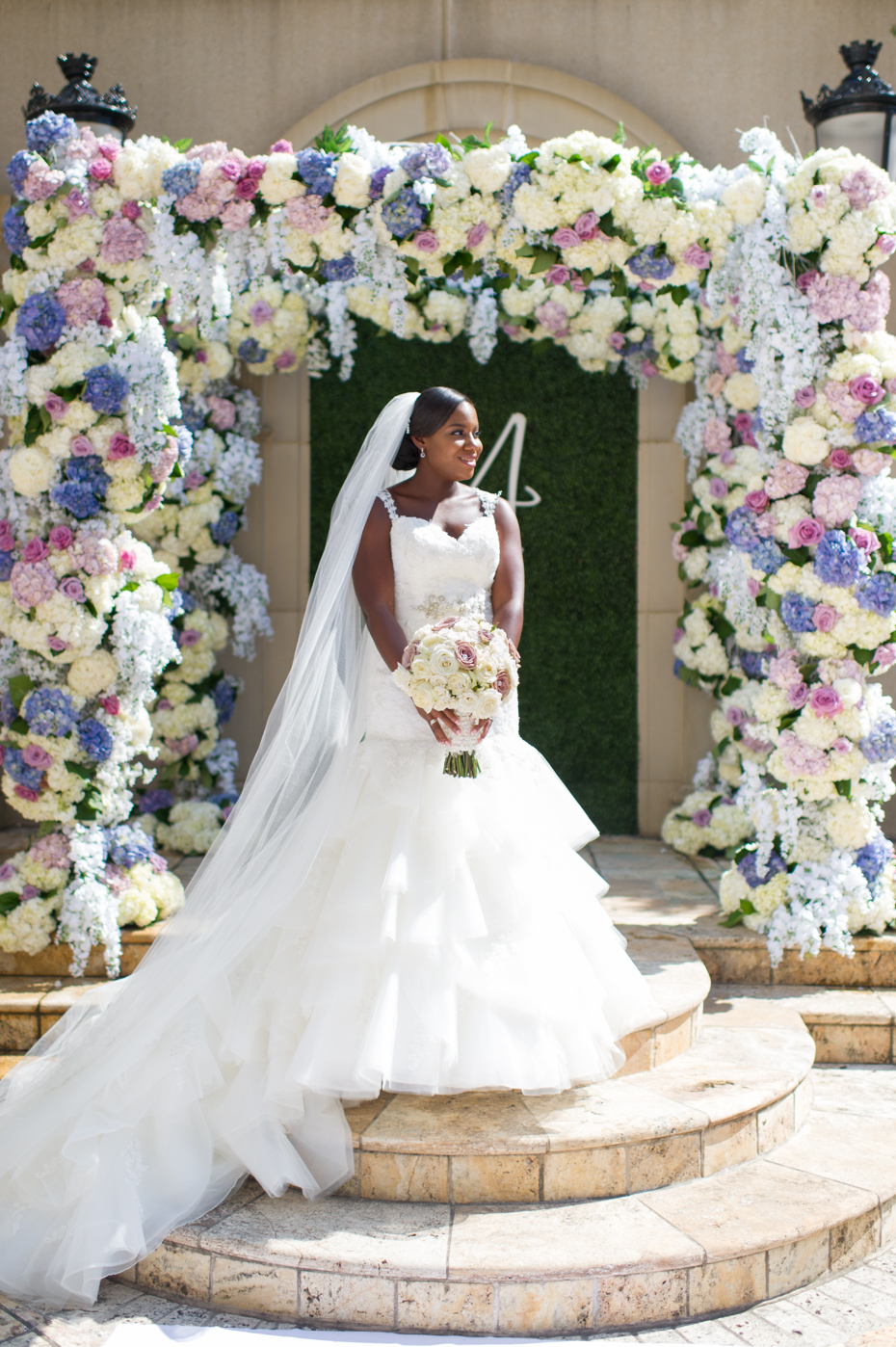 Bride in front of floral arbor by Legendary Events Atlanta