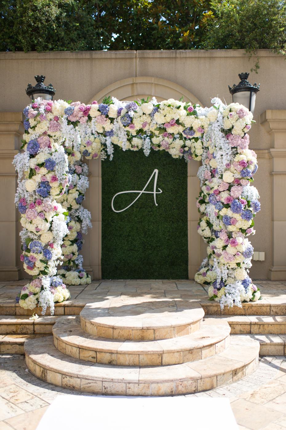 Flower covered arbor at St. Regis Atlanta by Legendary Events