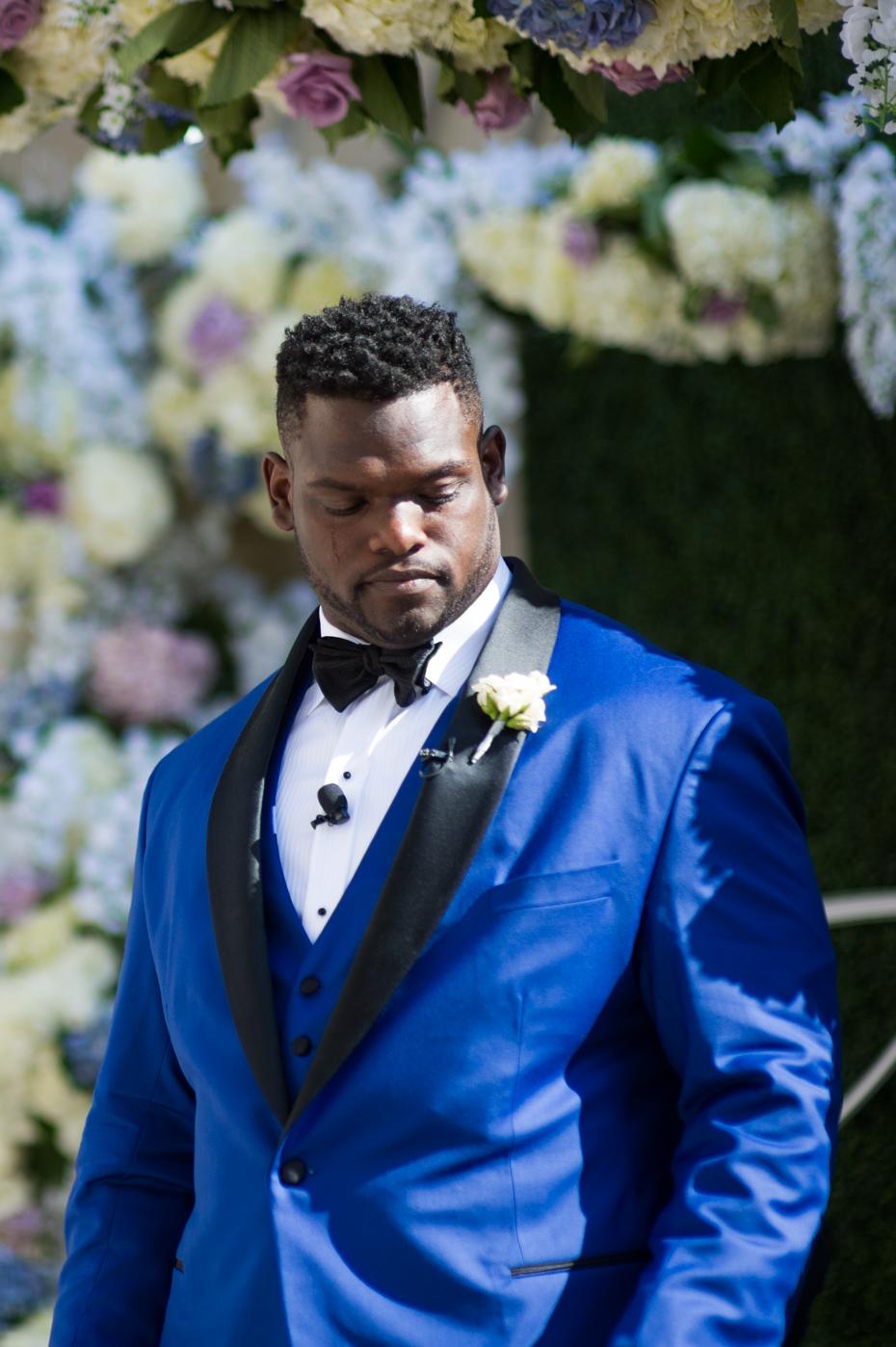 Emotional Groom watching bride walk down the aisle