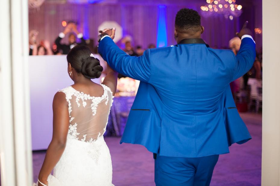 Geno Atkins and his wife entering their wedding reception at the St. Regis Atlanta