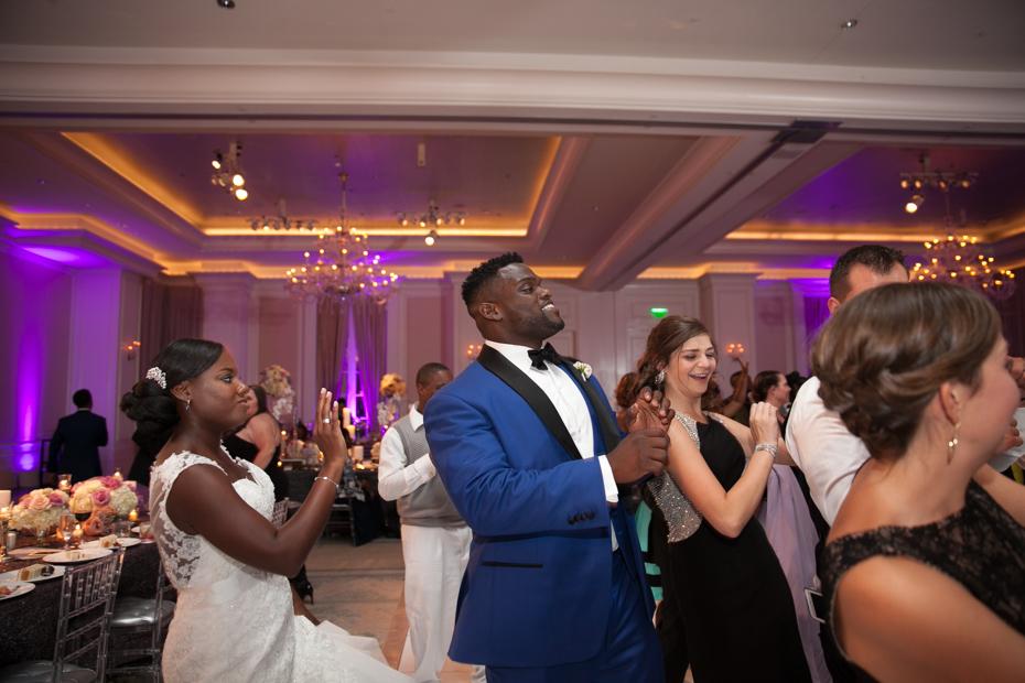 Kristen and Geno Atkins Dancing at their wedding