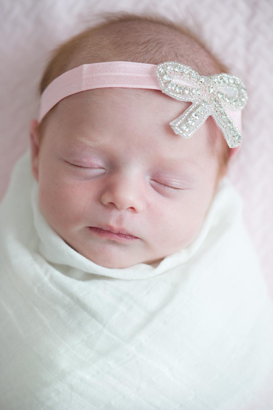 Newborn photo with bow